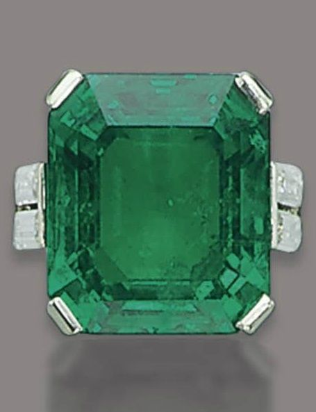 Art Deco Emerald Diamond Ring HENRI PICQ, CIRCA 1925. Set with a rectangular-cut emerald, weighing 22.58 carats, to the twin baguette-cut diamond shoulders, with French assay mark for platinum and maker's mark of Henri Picq. #HenriPicq #ArtDeco #ring