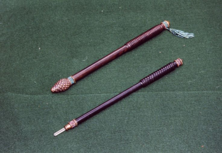Two wands - bronze and ebony (ebony taken from Victorian school rulers), with beadwork decoration by Heather Fenn-Edwards and quartz inset.