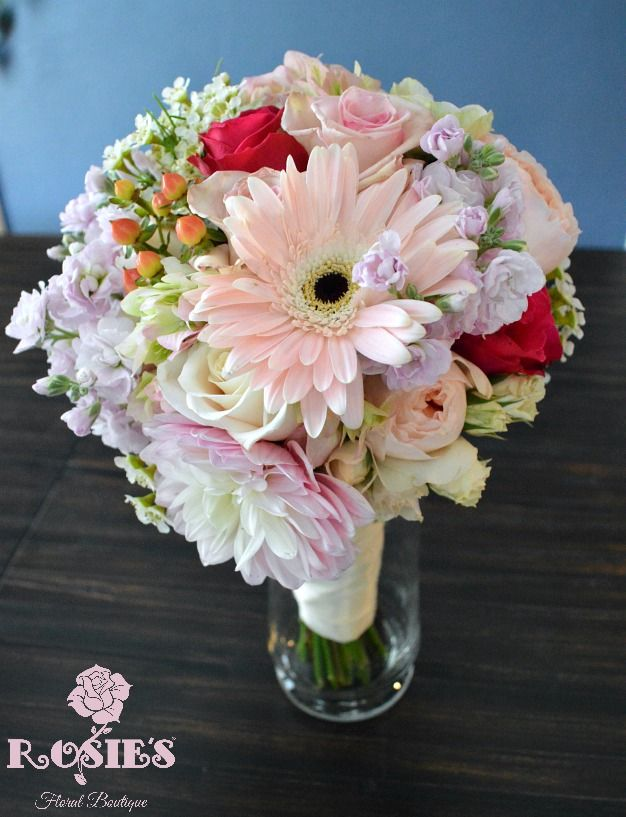 Fall wedding bridal bouquet including anemone, hypericum berries, garden roses, roses, wax flowers, stock, hydrangea, gerbera daisies, & alstroemeria. Wedding flowers and photography by Rosie's Floral Boutique.