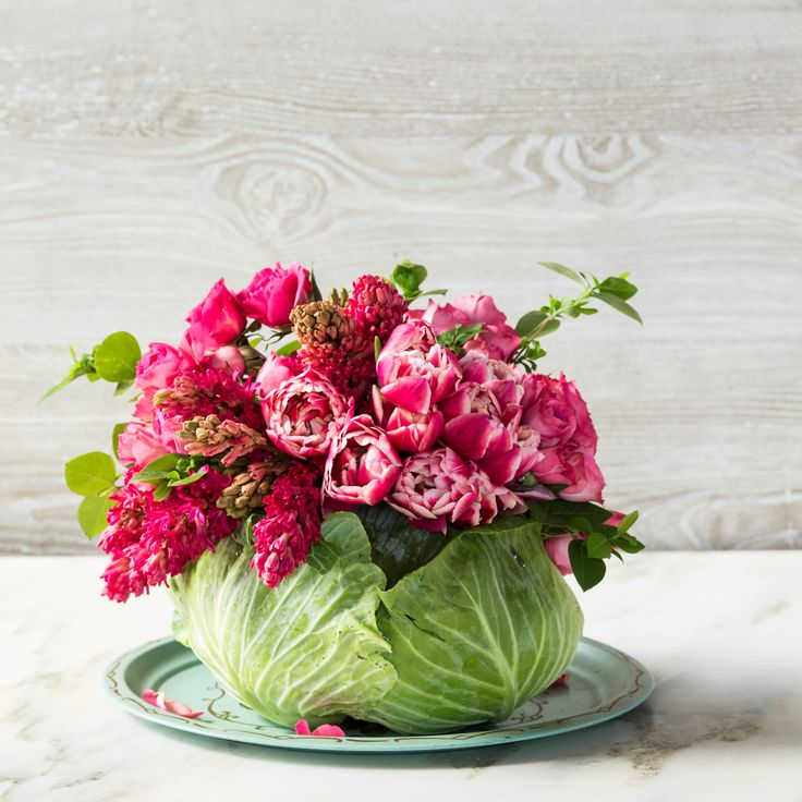 Love this cabbage vase with tulips, snap dragons and hyacinths.  How-to video at site.  (Fabulous tray it is displayed on, too!)