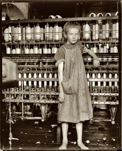 """February 1910. Addie Card, 12 years old, anemic little spinner in North Pownal Cotton Mill, Vermont. Girls in mill say she is ten years. She admitted to me she was twelve; that she started during school vacation and would """"stay."""""""