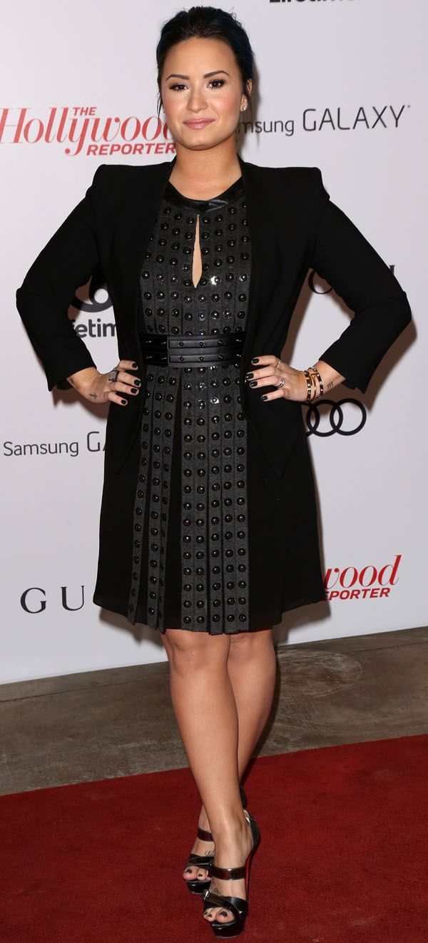 Demi Lovato at The Hollywood Reporter's Women in Entertainment Breakfast, which honored Oprah Winfrey, held at The Beverly Hills Hotel in Beverly Hills on December 11, 2013