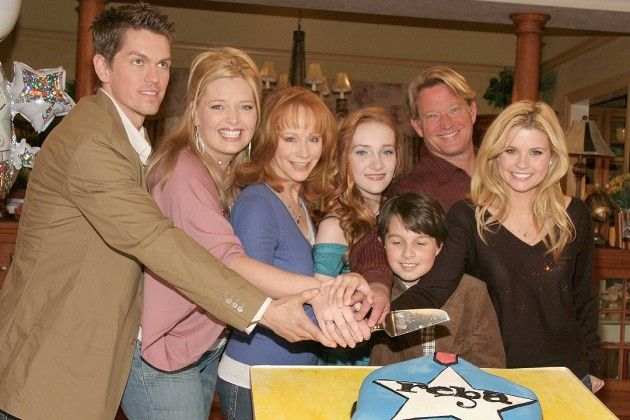 Christopher Rich, Joanna Garcia and Melissa Peterman, centered around McEntire's character, Reba Nell Hart, who lived across the street from her ex-husband and his new wife. Description from theboot.com. I searched for this on bing.com/images