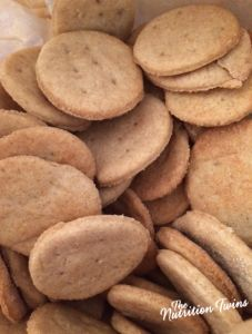 """Homemade Whole-Wheat """"Ritz"""" Crackers   1 cup whole wheat pastry flour 1.5 tsp baking powder ½ tbsp. sugar ¼ tsp salt 3 tsp unsalted butter, room temp – cut into pieces 2 tsp unsalted butter – melted (and put in a spray bottle if you have); you'll only need to use about half of the butter. 1 tbsp coconut oil ⅓ cup room temp water"""