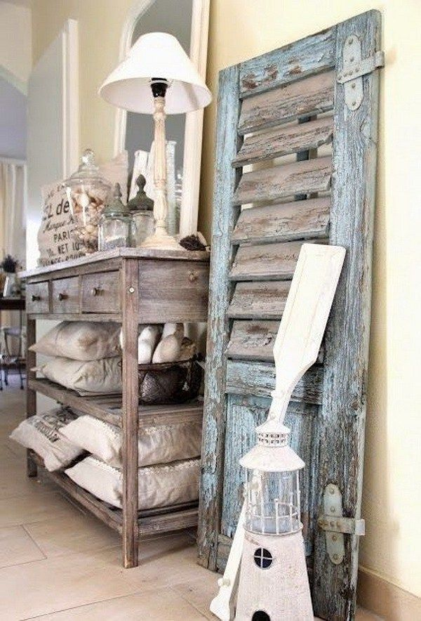 Vintage shutter decor leaning on wall and the rustic storage side table. love the rustic style for home decor!