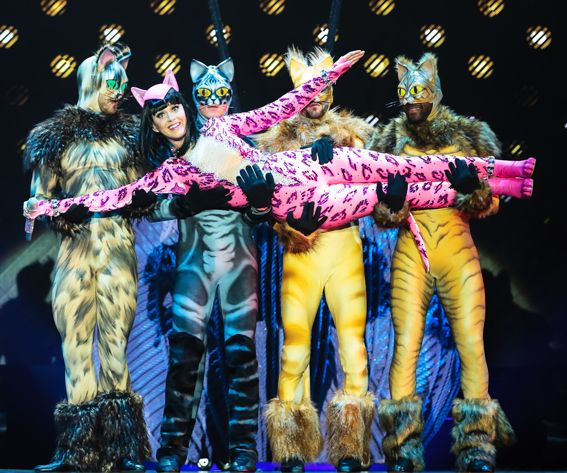 THE BLONDS This cat-oure look was classic Perry, and the pink skintight latex catsuit popped during her performance. Meow!