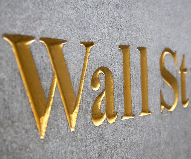What Is Wall Street: How It Works, History, and Crashes: Close up of Wall Street signage