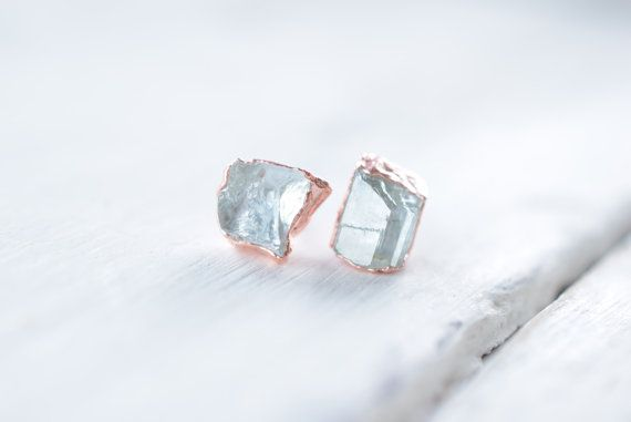 Gorgeous raw Aquamarine stud earrings made from recycled copper with a sterling silver post and backing. Set in a free-form setting, these are the perfect finishing touch for those with a wild heart!  PLEASE note that you will receive a pair of stud earrings similar to the photos above, each and every earring is handmade and each raw stone is different. No two pairs will ever be the same, much like the unique soul who will eventually wear them!  Thank you for looking x