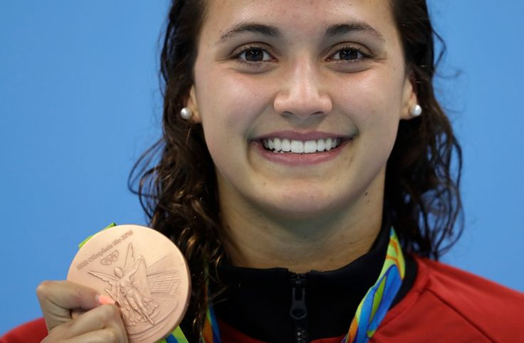 Canada's Kylie Masse shows off her bronze medal during the ceremony for the women's 100-meter backstroke final during the swimming competitions at the 2016 Summer Olympics, Monday, Aug. 8, 2016, in Rio de Janeiro, Brazil. (AP / Michael Sohn)