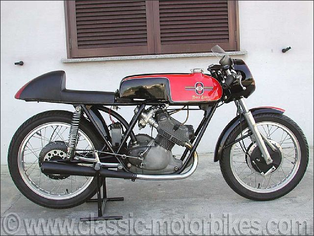 1957 Gilera Mosca Bianca 125 cc	1957 Gilera Mosca Bianca 125 cc	This ex-works twin 125 Gilera from 1957 was ridden by the Gilera works team rider Giovanni Lombardi. Twin cam shaft this bike is in an exceptional state of conservation.