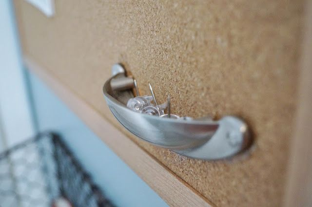 Don't Disturb This Groove: cabinet drawer cup pull used to hold push pins on a bulletin board
