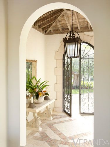 Entryway with Wrought Iron Doors and rustic pitched ceiling - Villa Perfecta by Jane Schwab and Cindy Smith of Circa Interiors via Veranda Magazine: