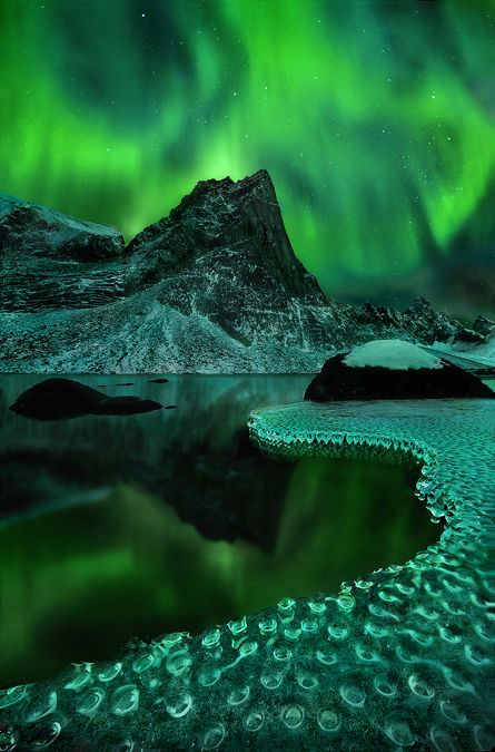 """Green Vision"" by Marc Adamus. Aurora borealis reflected on a frozen lakeshore in the Yukon Territory."
