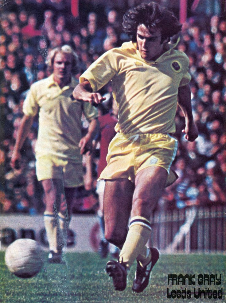 27th September 1975. Leeds United full back Frank Gray in action against Burnley and watched by team mate Terry Yorath.