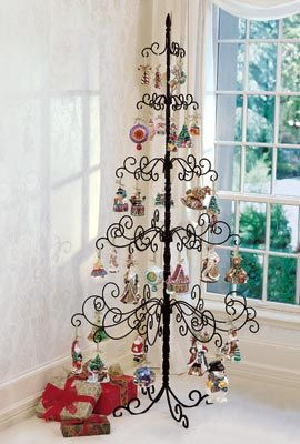 Wrought Iron Tree displays your Christmas ornaments. Great idea for apartments at