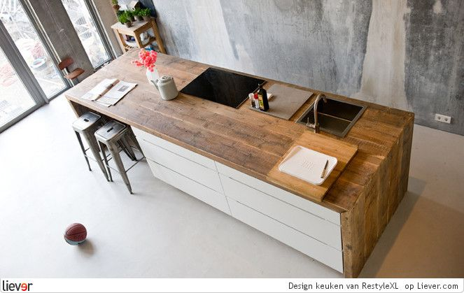 Gorgeous industrial kitchen island. Love the rustic wood and sleek white combo!
