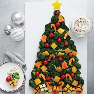 All it takes is a tray of artfully arranged veggies and a little creativity to make the prettiest edible Christmas tree around.