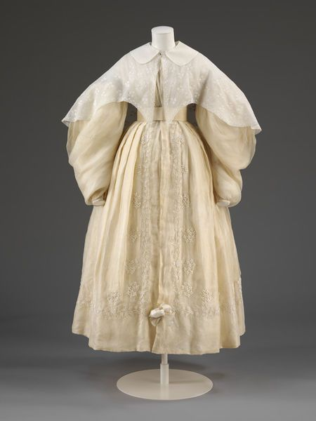 Wedding dress consisting of a pelisse robe with large imbecile sleeves and bell shaped skirt. l Victoria and Albert Museum #weddings #fashion