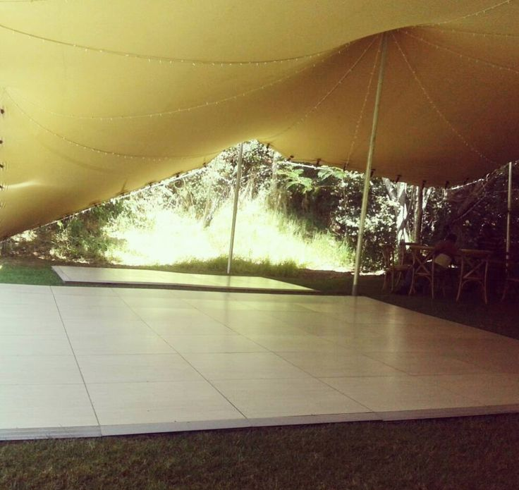 Pretty Pearl Teak under a marquee on the grass. #connectafloorcape #eventflooringcape town
