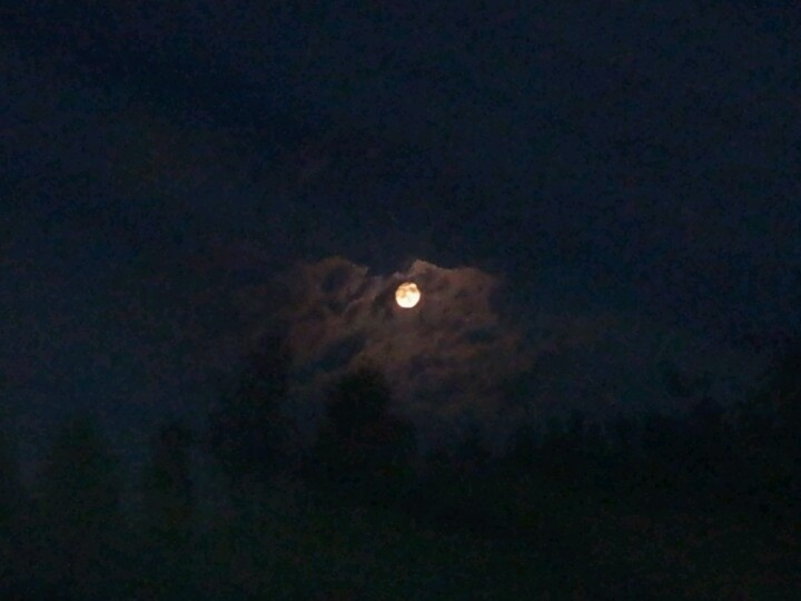 Moonlight behind clouds at August