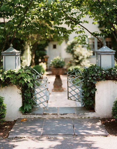 Garden pathway flanked by two lanterns. Urn in center of path. (Photo: Lonny)