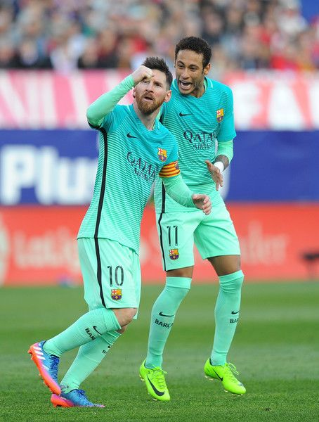 Lionel Messi of FC Barcelona celebratea with Neymar after scoring his 2nd goal during the La Liga match between Club Atletico de Madrid and FC Barcelona at Vicente Calderon Stadium on February 26, 2017 in Madrid, Spain.