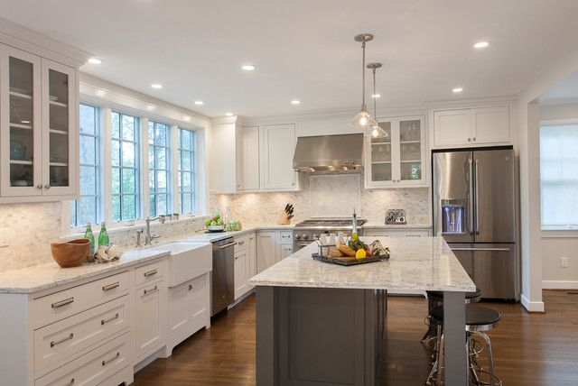 Design ideas for a large traditional l-shaped kitchen in Dc Metro with shaker cabinets, granite countertops, white backsplash, mosaic tile backsplash, stainless steel appliances, an island, a farmhouse sink, white cabinets and dark hardwood floors.Design ideas for a large contemporary kitchen in Dc Metro with a single-bowl sink, shaker cabinets, light wood cabinets, granite countertops, white backsplash, mosaic tile backsplash, stainless steel appliances, light hardwood floors and an…