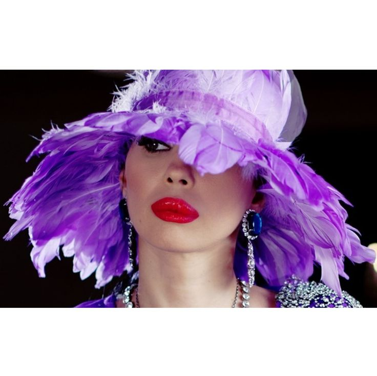 Ingrid Vlasov,feather hat,red lipstick,silever earrings,