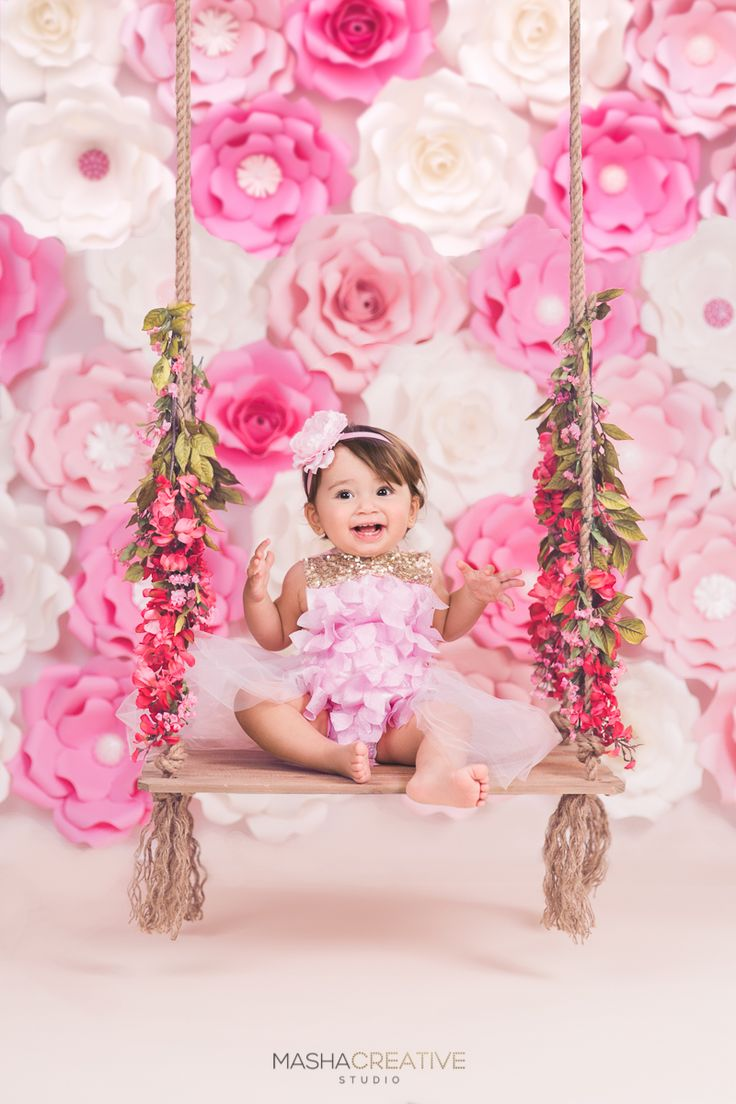 Pink, blush and white flower wall with romantic swing kids photoshoot cake smash