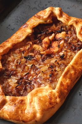 A feast with only five ingredients? How could it be? I'll tell you how--with flaky pastry, two bubbly cheeses, golden onions, and a few slices of butter. This caramelized onion tart is a feast fit for any festivity.
