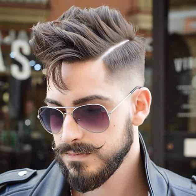 Medium Beard With Curved Mustache and Fade Hair