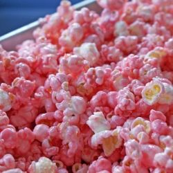 Pink candied popcorn - easy to make using cherry or raspberry Jell-O gelatin powder.  Can handmake or order.  Party Favor