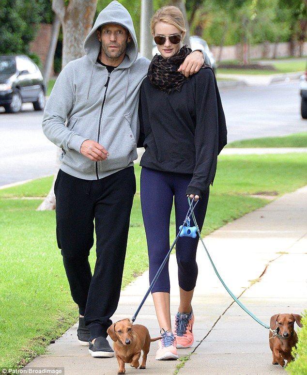 Puppy love: Jason Statham and his younger model girlfriend Rosie Huntington-Whiteley enjoy...