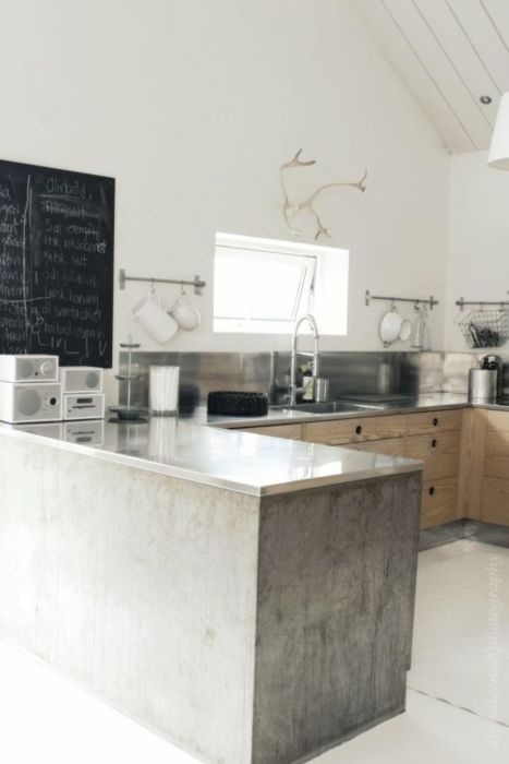 stainless. concrete framed counter area. low profile cabinets.