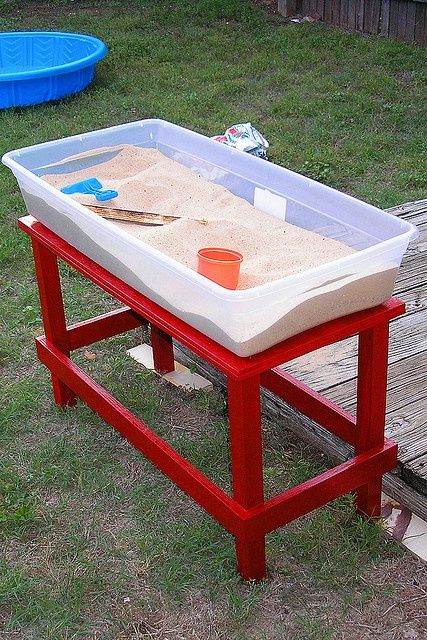 Plastic bins are great for a backyard sand table. Just put the lid on when you're done! Nice!