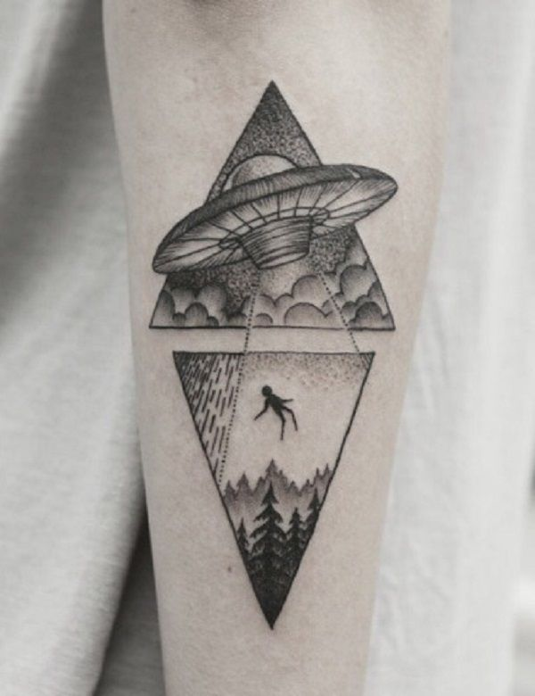 A quirky Triangle Glyph Tattoo design. You can see two triangle symbols, one which is inverted and in the design a spaceship is hovering above a forest. It also looks as if it's summoning a body into the ship with a beam of light.