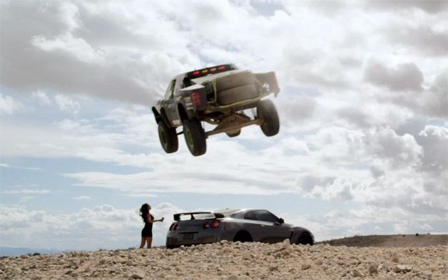 Trophy Truck jumps a GT-R