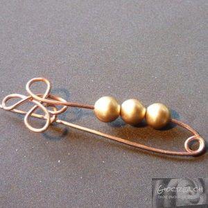 Spilla perle legno dorato