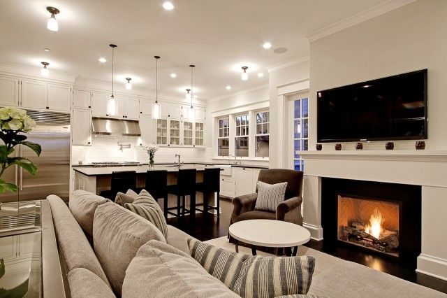 Chic Comfy Cozy Open Living Room Kitchen Design With Gray Sofa Striped Pillows Fireplace TV And Brown Velvet Chair