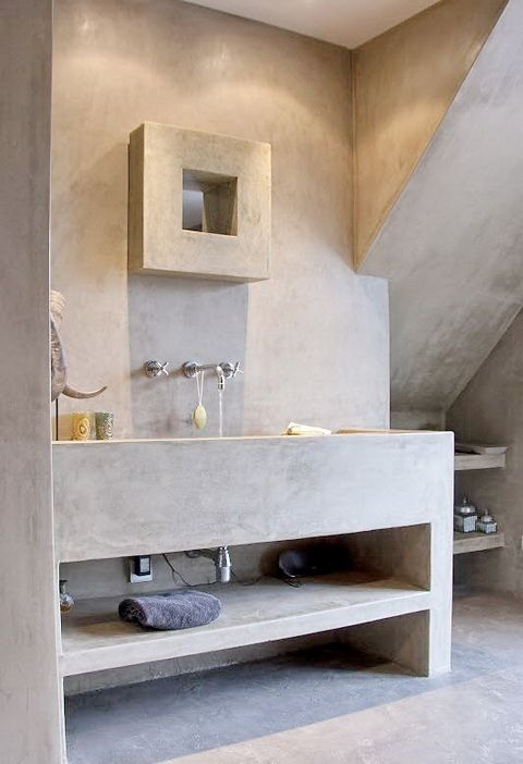 Each item within this bathroom has been made from the same material, concrete. This gives it a very smooth and relaxed atmopshere as there isn't too many different things happening at once.
