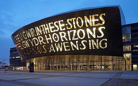 Wales Millennium Centre in Cardiff, home of the Welsh National Opera. Calligraphy reads- Creu Gwir Fel Gwydr O Ffwrnais Awen (Welsh) ... In These Stones Horizons Sing (English).