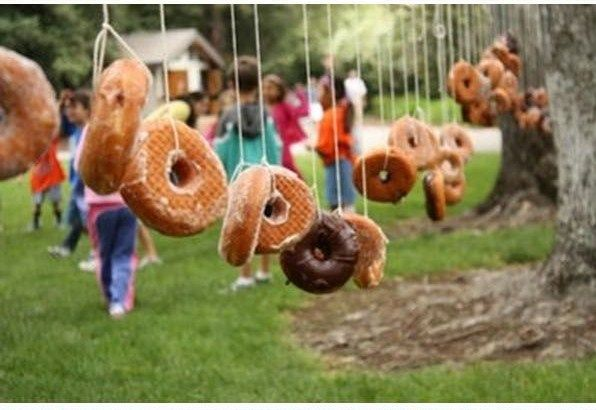 Doughnut bobbing is a good alternative to apple bobbing to entertain the kids at your PTA/ PTO Bonfire Night  / Firework display.