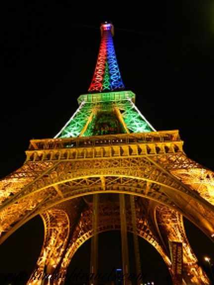Paris, France on Bastille Day. Check out the gorgeous Eiffel Tower at night with the festive colors of their flag!