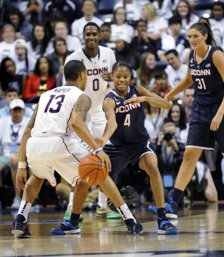 Moriah Jefferson pressures Shabazz Napier during the first-ever men's and  women's inter-squad scrimmage at UConn's First Night at Gampel Pav.