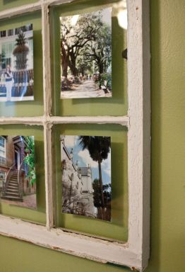 Photos displayed in an old window frame