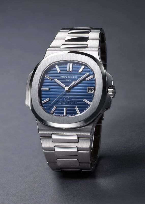 Patek Philippe Nautilus 5711 40th Anniversary - this platinum-cased tribute to the 1970s original features a 44 mm case and a dark blue, 18K gold, dial with a bright-to-dark sunburst gradation from the inside to the outside.  It is limited to 700 pieces.  More @ visit: http://www.watchtime.com/wristwatch-industry-news/watches/patek-philippe-celebrates-40-years-of-the-nautilus-with-new-limited-editions/ #patekphilippe #watchtime  #luxurywatch #watchnerd
