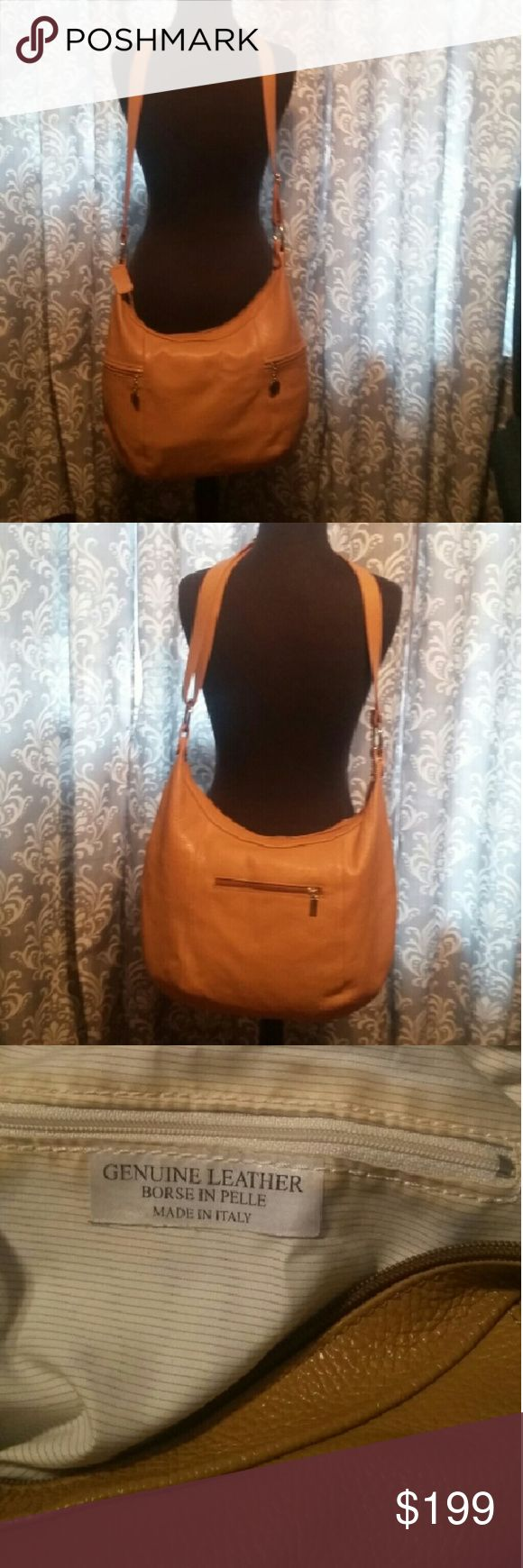 Borse in Pelle Leather Purse Borse in Pelle leather hobo purse. This bag is a camel color and it is beautiful. The leather on it is so soft, no scratches just 2  very faint pen marks.  The strap on it is adjustable. Borse in Pelle Bags Hobos