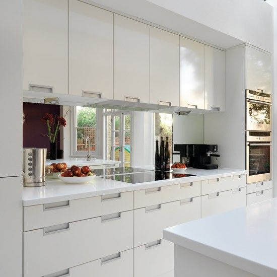 Make a small kitchen look bigger Mirrored splash back.....definitely an idea