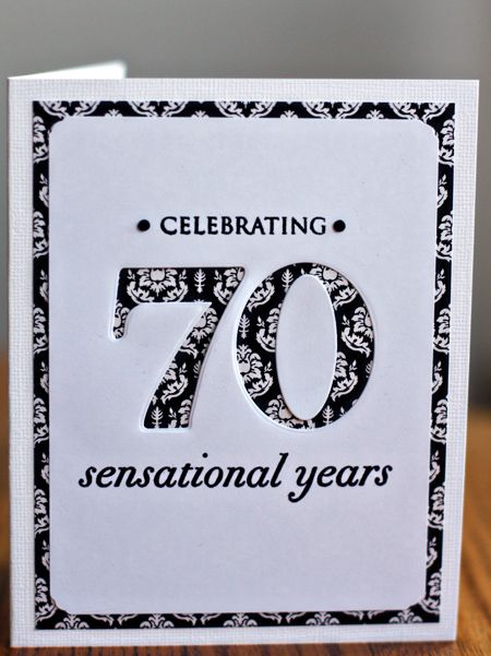 handmade birthday card: Celebrating70 ... like the way the first layer with patterned paper shows around the edges and through the negative die space 70 ... black and white ...