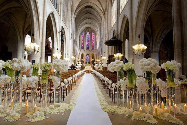 An abundance of floral arrangements greet guests at the ceremony